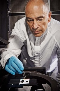 Principal Investigator John Hagopian working with a nanotube material sample. Image Credit: NASA Goddard/Chris Gunn